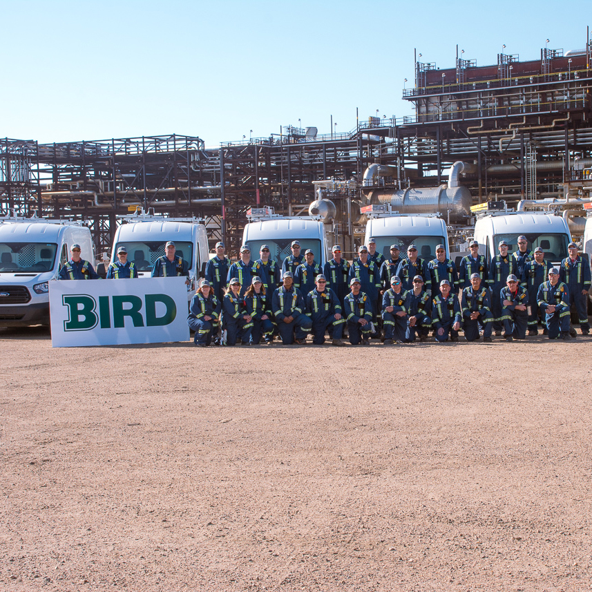 team of Bird site employees in front of industrial site
