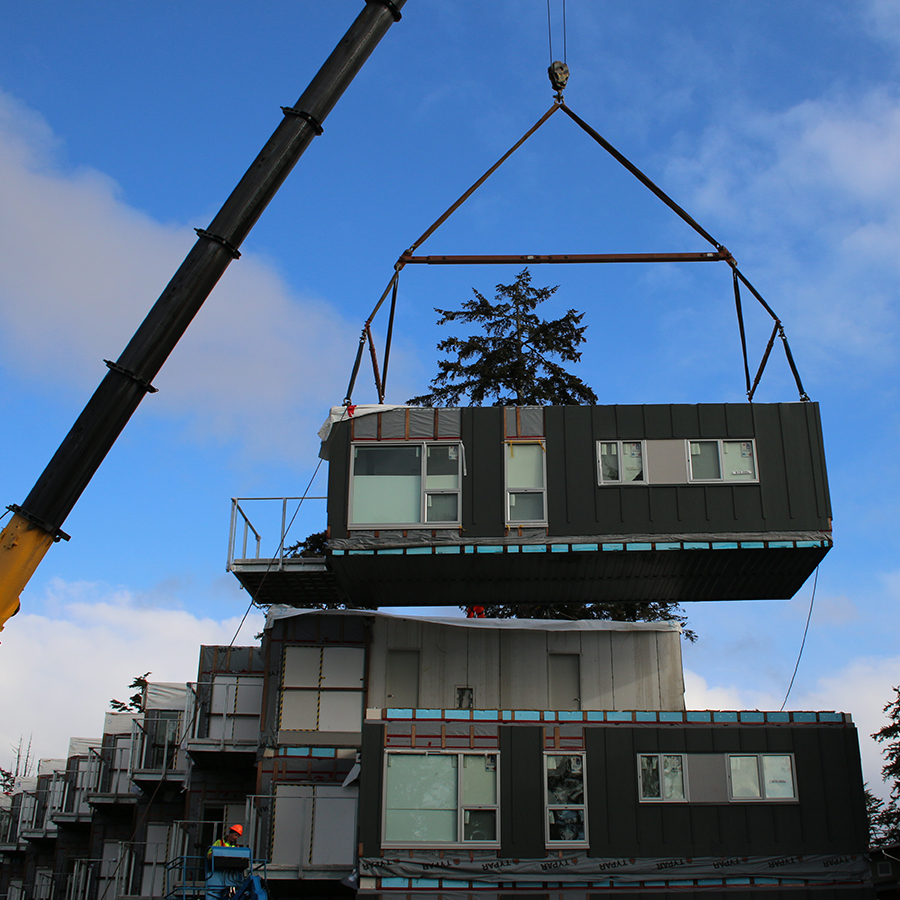 crane lifting modular unit into place