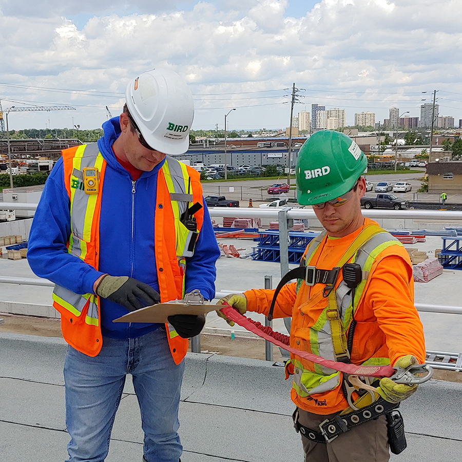 Two construction workers with safety gear