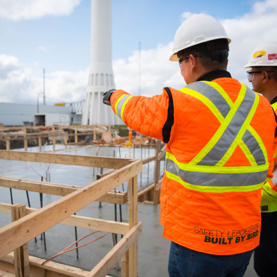 worker pointing to construction underway